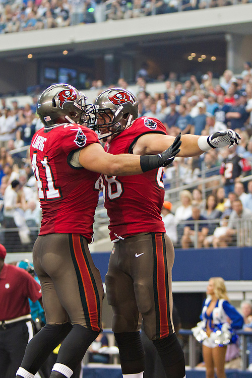 DALLAS, TX - SEPTEMBER 23:  Luke Stocker #88 and Erik Lorig #41 of the Tampa Bay Buccaneers bump chest in celebration after a touchdown against the Dallas Cowboys at Cowboys Stadium on September 23, 2012 in Dallas, Texas.  The Cowboys defeated the Buccaneers 16-10.  (Photo by Wesley Hitt/Getty Images) *** Local Caption *** Luke Stocker; Erik Lorig