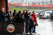 Fans of Sheffield United take shelter before the Premier League match between Sheffield United and Burnley at Bramall Lane, Sheffield, England on 2 November 2019.