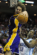 Los Angeles Lakers center Pau Gasol, left, of Spain grabs a rebound in front of Orlando Magic center Dwight Howard during the second half of their NBA basketball game in Orlando, Florlda.