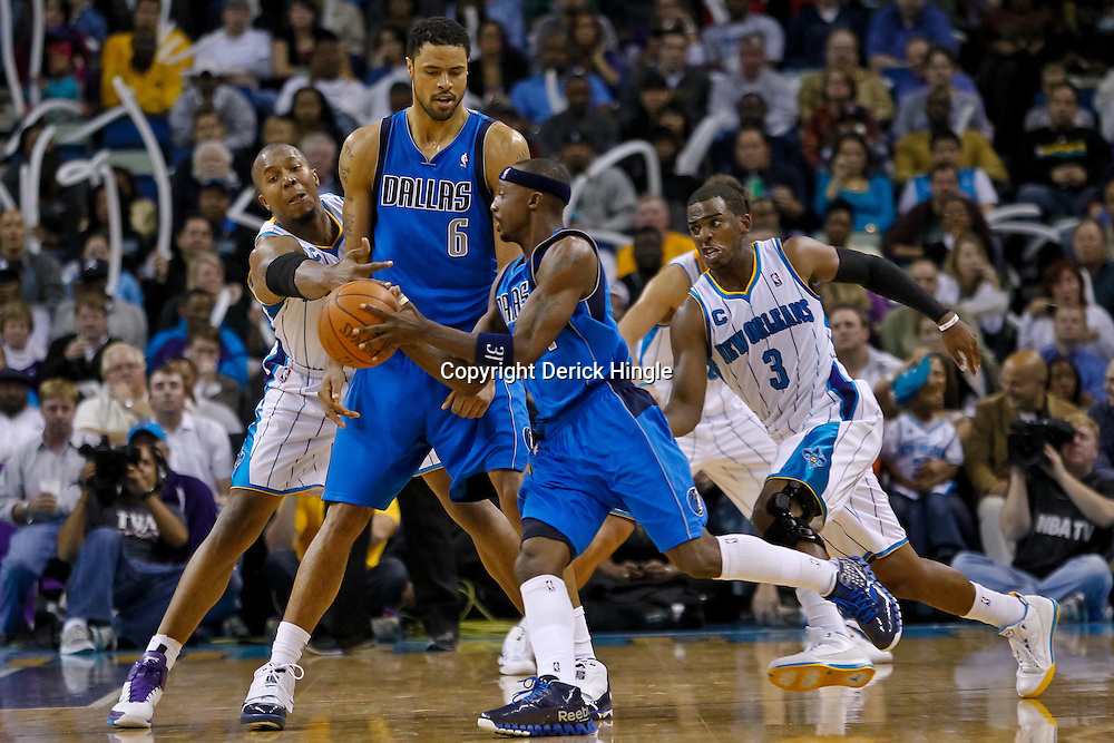 November 17, 2010; New Orleans, LA, USA; Dallas Mavericks center Tyson Chandler (6) passes to shooting guard Jason Terry (31) during the second half as New Orleans Hornets power forward David West (30) and point guard Chris Paul (3) defend the play at the New Orleans Arena. The Hornets defeated the Mavericks 99-97. Mandatory Credit: Derick E. Hingle