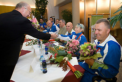 Mateja Pintar with bronze paraolympic medal accepts congratulations from Bogdan Gabrovec of OKS at welcome ceremony at Airport Joze Pucnik, on September 20, 2008, in Brnik, Slovenia. (Photo by Vid Ponikvar / Sportal Images)./ Sportida)