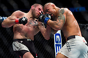 Jim Miller connects with a punch against Thiago Alves during UFC 205 at Madison Square Garden in New York, New York on November 12, 2016.  (Cooper Neill for The Players Tribune)