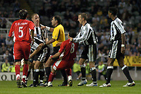 Photo. Glyn Thomas. <br /> Newcastle United v Hapoel Bnei Sakhnin. <br /> UEFA Cup, 1st round, 1st leg. 16/09/2004.<br /> Newcastle's Nicky Butt (second from L) lands a punch on Abas Suan (#8) which led to both players being shown the red card<br /> NORWAY ONLY