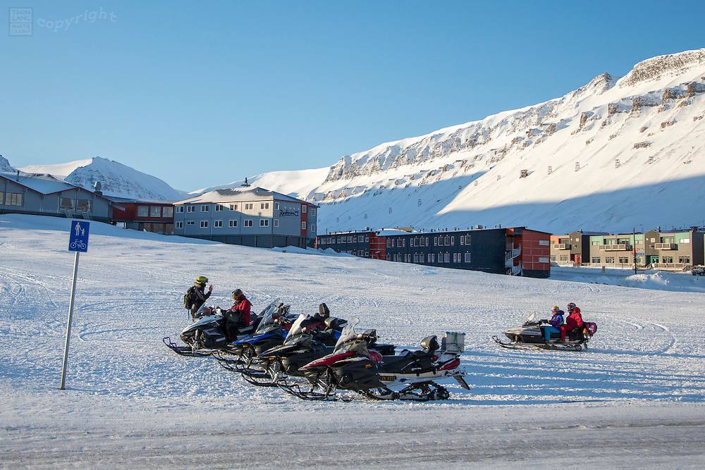Snow mobiles parked on Svalbard, Norway during the 2015 total solar eclipse