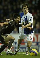 Photo: Aidan Ellis.<br /> Blackburn Rovers v Tottenham Hotspur. The Barclays Premiership. 19/11/2006.<br /> Blackburn's Morten Gamst Pedersen (R) battles with Spurs Lee Young Pyo