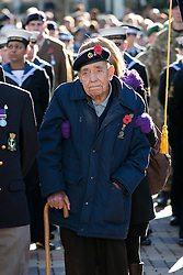 © Licensed to London News Pictures. 10/11/2013. Birmingham, UK. Pictured, eighty seven years old former service man Ray Gough from Birmingham, stands through the whole service, with a little help. Birmingham Remembrance Service, Millennium Square. Photo credit : Dave Warren/LNP