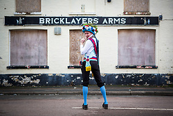 © Licensed to London News Pictures. 13/01/2018. Whittlesey UK. A member of Earlsdon Morris this morning at the 39th Whittlesey Straw Bear Festival taking place today. In times past when starvation bit deep the ploughmen of the area where drawn to towns like Whittlesey, They knocked on doors begging for food & disguised their shame by blackening their faces with soot. In Whittlesey it was the custom on the Tuesday following Plough Monday to dress one of the confraternity of the plough in straw and call him a Straw Bear. The bear was then taken around town to entertain the folk who on the previous day had subscribed to the rustics, a spread of beer, tobacco & beef. The bear was made to dance in front of houses & gifts of money, beer & food was expected.Photo credit: Andrew McCaren/LNP