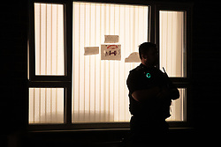 © Licensed to London News Pictures. 25/05/2020. Brinnington, UK. A police officer guards the front of a house off Blackberry Lane , understood to be related to the investigation . Police have sealed off several areas of Brinnington Vale , near Stockport , adjacent to flats and houses , after the discovery of human body parts in Reddish Vale Country Park . Greater Manchester Police this evening (25th May 2020) say they've arrested a 48 year old man on suspicion of the murder of a woman in her 40s . Photo credit: Joel Goodman/LNP