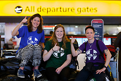 © Licensed to London News Pictures. 22/11/2014. LONDON, UK. NHS Staff (L to R) Annabel Allcorn, Angela Mcbride and Lizzie Marmont join 33 NHS doctors, nurses and paramedics who are leaving Heathrow Terminal 4 for Freetown, Sierra Leone to start working at British-built Ebola treatment centres across the country with the help of GOAL, a Dublin-based international aid agency on UK Government's order. Photo credit : Tolga Akmen/LNP