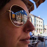 Buildings of Soria city center reflected on a sunglasses, Soria, Spain