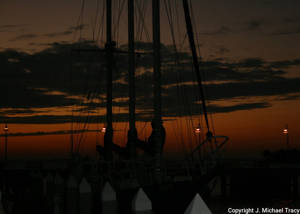 A large sail diving boat docked at a Key West dock, sunset taken with natural light.