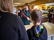 28 NOVEMBER 2019 - DES MOINES, IOWA: US Senator AMY KLOBUCHAR (D-MN), talks to volunteers at the South Des Moines Community Center. Sen Klobuchar served Thanksgiving lunches to people at the center. Sen. Klobuchar is campaigning to be the Democratic nominee for the US Presidency. Iowa holds the first selection event of the Presidential election cycle. The Iowa caucuses are Feb. 3, 2020.               PHOTO BY JACK KURTZ