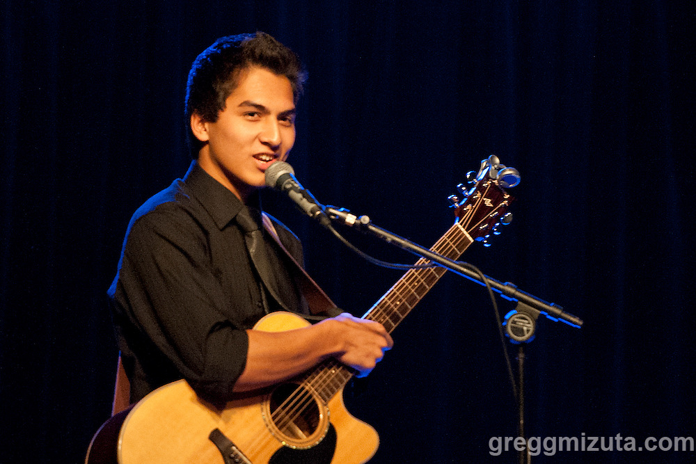 Jared Nilo performs an original song during the Chamber Dances event at the Visual Art Collective, Garden City, Idaho on August 26, 2016.<br /> <br /> Chamber Dances was a collaboration between Surel's Place cellist-in-residence Dave Eggar and Boise&rsquo;s LED dancers, Lauren Edson and Brett Perry. Accompanied by Heather Mastel-Lipson (Portland, OR) on violin, and Mario Diaz (Portland) on classical guitar, Eggar performed chamber works by Bach, Villa-Lobos, Kodaly, Ravel, Gershwin and Faure. Lauren Edson choreographed dance that she and Perry performed alongside Eggar&rsquo;s trio. Original compositions also performed by Andrew Stensaas and Jared Nilo.