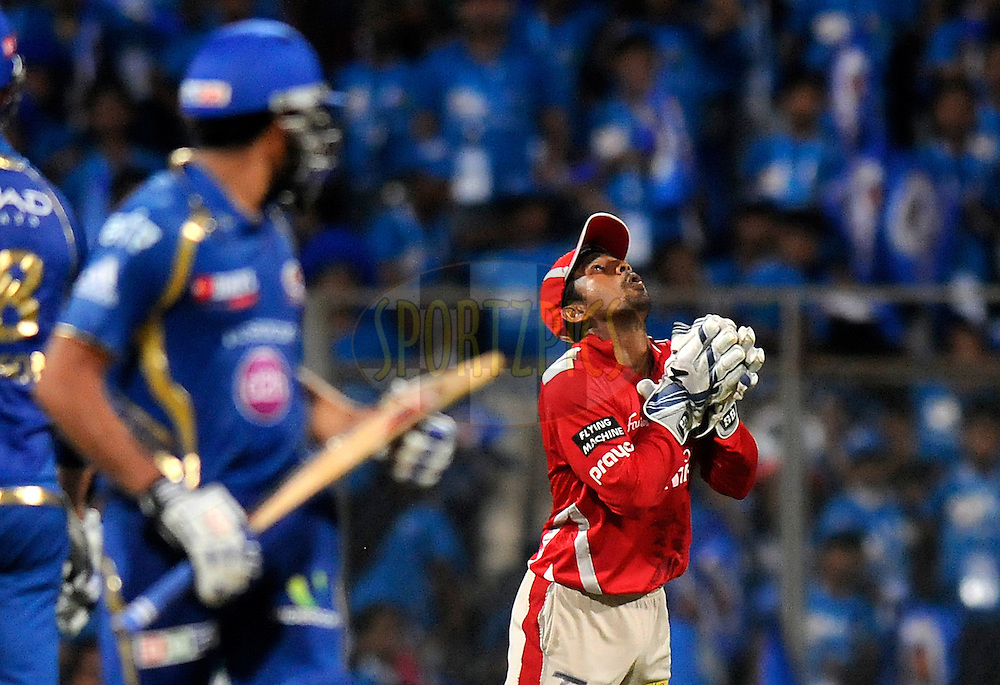 Rohit Sharma captain of the Mumbai Indians looks on as Wriddhiman Saha of the Kings X1 Punjab completes a catch to get his wicket during match 22 of the Pepsi Indian Premier League Season 2014 between the Mumbai Indians and the Kings XI Punjab held at the Wankhede Cricket Stadium, Mumbai, India on the 3rd May  2014<br /> <br /> Photo by Pal Pillai / IPL / SPORTZPICS<br /> <br /> <br /> <br /> Image use subject to terms and conditions which can be found here:  http://sportzpics.photoshelter.com/gallery/Pepsi-IPL-Image-terms-and-conditions/G00004VW1IVJ.gB0/C0000TScjhBM6ikg