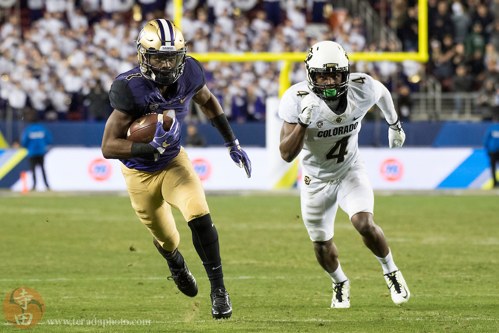 December 2, 2016; Santa Clara, CA, USA; Washington Huskies wide receiver John Ross (1) runs the football against Colorado Buffaloes defensive back Chidobe Awuzie (4) during the third quarter in the Pac-12 championship at Levi's Stadium. The Huskies defeated the Buffaloes 41-10.
