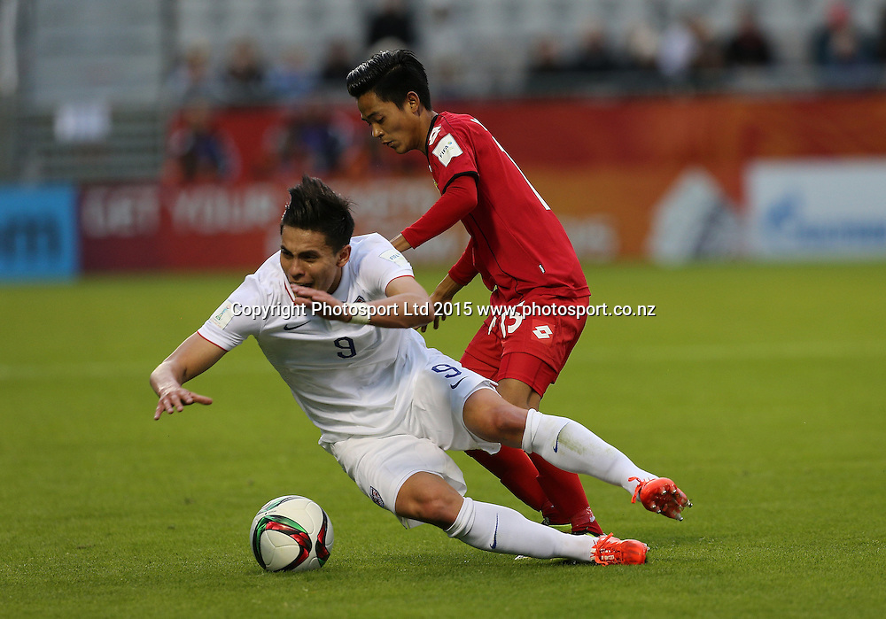 Alex Rufer of New Zealand is brought down by Yan Naing Oo of Myanmar in the Group A FIFA U20 World Cup Match between USA and Myanmar at Northlands Event Centre, Whangarei, Northland, New Zealand, Saturday, May 30, 2015. Copyright photo: David Rowland / www.photosport.co.nz