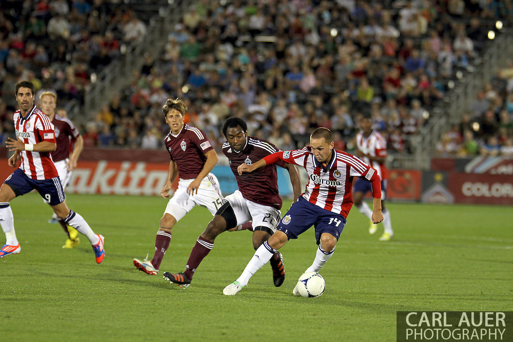 August 18th, 2012: Chivas USA forward Casey Townsend (14) tries to free himself up for a shot against the Colorado Rapids in the second half at Dick's Sporting Goods Park