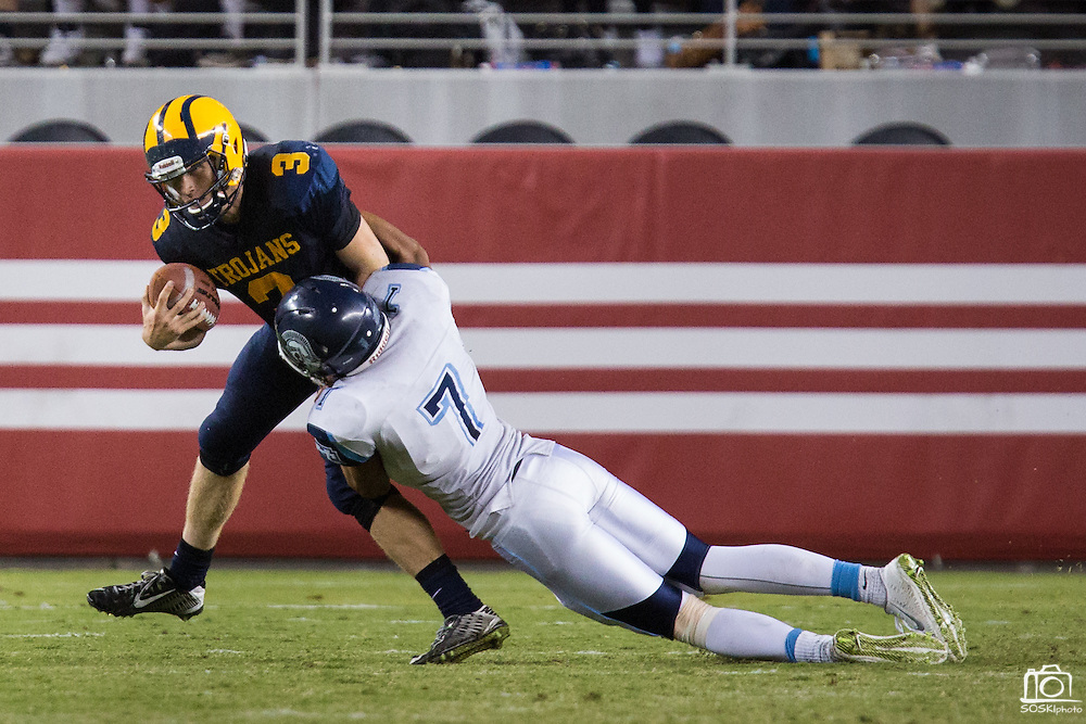 Milpitas quarterback Oliver Svirsky, 3, is sacked in the final seconds of the game by Valley Christian's defensive end RJ Stone, 7, during Friday Night Lights at Levi's Stadium in Santa Clara, California, on September 18, 2015.  Milpitas went on to lose 22-21 against Valley Christian.  (Stan Olszewski/SOSKIphoto)