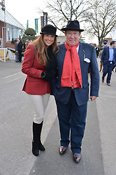 ANDREW NEIL and SUSAN NILSSON at the 2013 Hennessy Gold Cup at Newbury Racecourse, Berkshire on 30th November 2013.