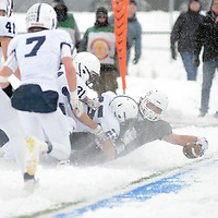 Laura Stoecker/lstoecker@dailyherald.com<br /> Glenbard West's Sam Brodner reaches out in an attempt to score a touchdown as Cary-Grove's David Daigle takes him down in the fourth quarter of the Class 7A semifinal at Glenbard South High School in Glen Ellyn Saturday. A penalty flag was thrown and Glenbard West had to repeat the down.