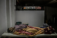 """The body of """"Kulot"""", a user of methamphetamine (""""shabu"""") who was a victim in President Duterte's """"War on Drugs"""".  His body sat in this morgue for over 25 days because his widow, Sara, who lives in Market 3 slum could not afford a burial.  Finally his body was interred in a mass grave.  Navotas, Metro Manila, Philippines"""