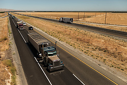 June 16, 2017 - Mendota, California, U.S - Trucks pass through the Interstate 5 across California's Central Valley in Mendota, California. A heat wave has made its way to California from the southwestern United States. (Credit Image: © Joel Angel Juarez via ZUMA Wire)