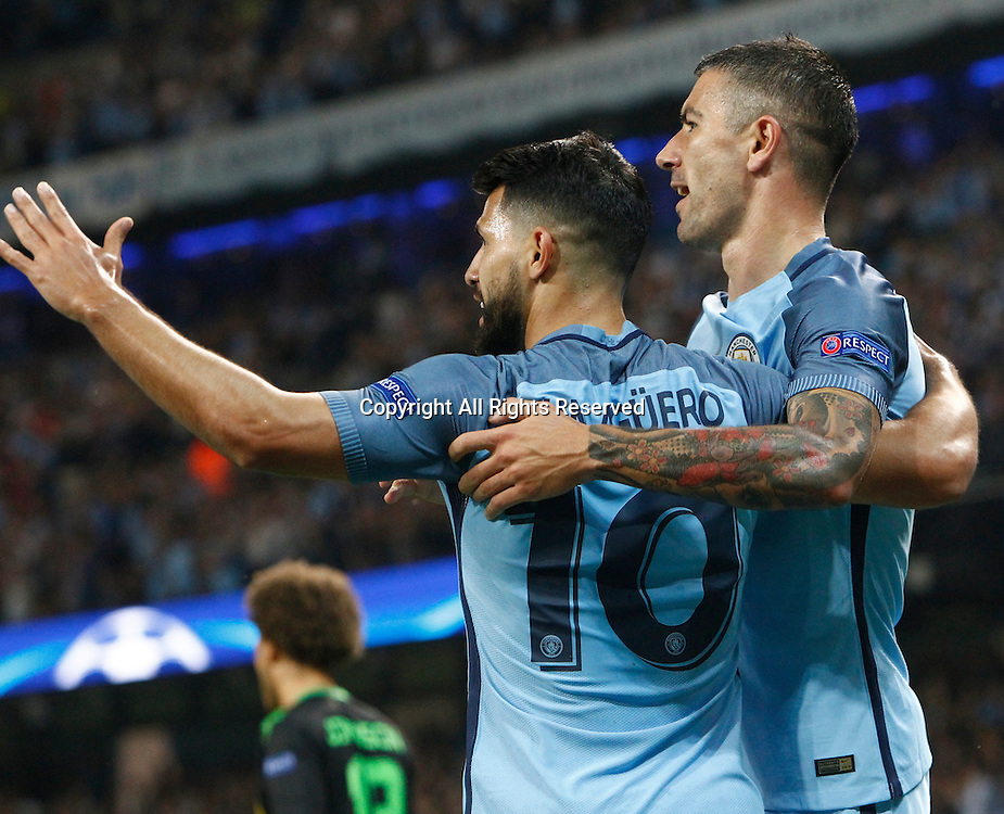 14.09.2016. The Etihad, Manchester, England. UEFA Champions League Football. Manchester City versus Borussia Monchengladbach. Manchester City striker Sergio Agüero (10) and Manchester City defender Aleksander Kolarov (11) celebrate Aguero's opening goal in the 8th minute 1-0.