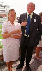 MAJOR CHRISTOPHER & MRS HANBURY at a race meeting in West Sussex on 30th July 1999.MUP 6