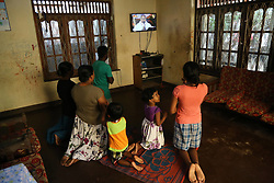 April 28, 2019 - A Sri lankan Catholic family prays at their home in negombo on 28 April, 2019. His Eminence Cardinal Malcolm Ranjith conducts special sunday mass at the Catholic Archbishop's House as people are unable to go to the church. (Credit Image: © Pradeep Dambarage/ZUMA Wire)