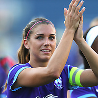 Orlando Pride forward Alex Morgan (13) salutes the fans after winning a NWSL soccer match against the Seattle Reign FC at Camping World Stadium on May 8, 2016 in Orlando, Florida. (Alex Menendez via AP)
