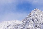 Mount Morgan emerging from clouds after a winter storm, John Muir Wilderness, Sierra Nevada Mountains, California