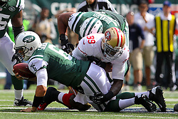 Sept 30, 2012; East Rutherford, NJ, USA; New York Jets quarterback Mark Sanchez (6) is sacked by San Francisco 49ers outside linebacker Aldon Smith (99) during the first half at MetLIfe Stadium.