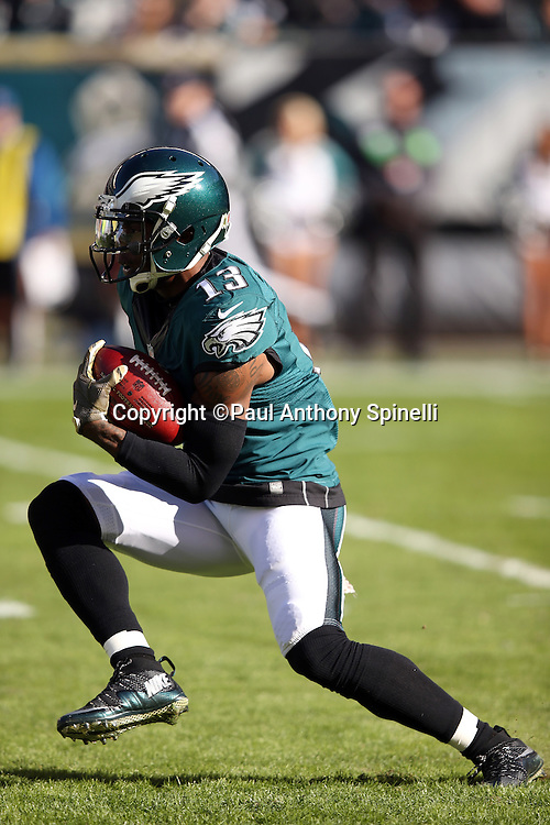 Philadelphia Eagles wide receiver Josh Huff (13) runs with the ball after catching a pass while warming up before the 2015 week 10 regular season NFL football game against the Miami Dolphins on Sunday, Nov. 15, 2015 in Philadelphia. The Dolphins won the game 20-19. (©Paul Anthony Spinelli)