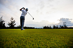 Swing of a player at the Montgomerie Links golf course, Danang, Vietnam, Southeast Asia
