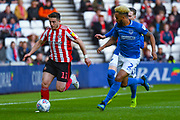 Lynden Gooch of Sunderland (11) and Anton Walkes of Portsmouth (2) in action during the EFL Sky Bet League 1 first leg Play Off match between Sunderland and Portsmouth at the Stadium Of Light, Sunderland, England on 11 May 2019.