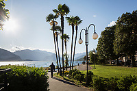 VERBANIA, ITALY - 18 APRIL 2017: A man walks his dog by the Lake Maggiore in Verbania, Italy, on April 18th 2017.<br /> <br /> Emma Morano was an Italian supercentenarian who, prior to her death at the age of 117 years and 137 days, was the world's oldest living person whose age had been verified, and the last living person to have been verified as being born in the 1800s. She died on April 15th 2017.