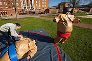 Kara Schauf celebrates have putting her friend Taryn Meidle on her back while sumo wrestling during the Extreme on the Green event April 16, 2014.  Leading up to finals, a variety of activities are planed to celebrate spring and the end of the school year at Ohio University.  Photo by Ohio University / Jonathan Adams