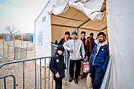 A group of Syrian and Afghans refugees is  preparing to cross the Greek-Macedonian border at the village of Idomeni, Greece, 8 Febraury 2016.<br /> Hundreds of refugees arrive at Idomeni and cross the border between Greece and Macedonian on their journey to North Europe.