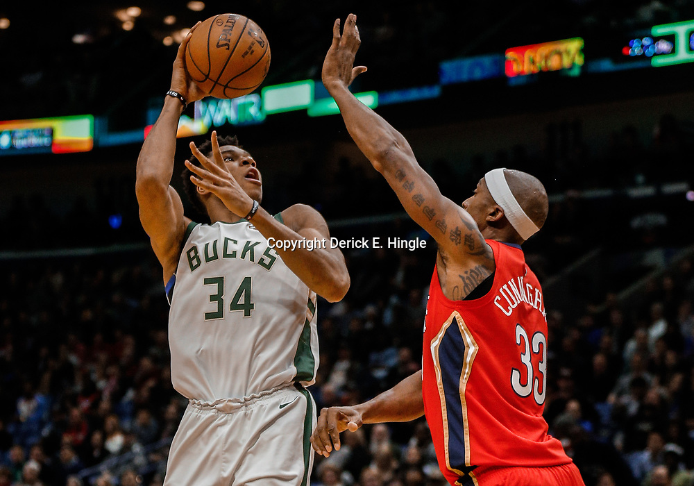 Dec 13, 2017; New Orleans, LA, USA; Milwaukee Bucks forward Giannis Antetokounmpo (34) shoots over New Orleans Pelicans forward Dante Cunningham (33) during the first quarter at the Smoothie King Center. Mandatory Credit: Derick E. Hingle-USA TODAY Sports