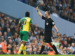 Cameron Jerome of Norwich City receives a yellow card  - Mandatory byline: Matt McNulty/JMP - 07966 386802 - 31/10/2015 - FOOTBALL - City of Manchester Stadium - Manchester, England - Manchester City v Norwich City - Barclays Premier League