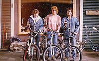 Bill Marlowe, Greg Potvin, and Joe Nowakowski in front of the Quickstop Bike Shop in Marquette, MI.  1983 or 1984