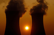 As an early sun rises, the twin stacks of Richborough cooling Towers make silhouettes against the golden morning light. Now decommissioned, these industrial giants of the landscape are sending clouds of steam vapour into the air, in the county of Kent. Nature can be seen competing with 20th Century technology as solar energy is seen against the war power being generated. From 1962-1971 Richborough burned coal from collieries. In 1971 the station was converted to burn oil. Too costly to run plant underwent trials on an experimental fuel called Orimulsion, a cheap heavy oil and water-based emulsion produced form natural bitumen from Venezuela. Initial results or trials suggested it would make a cheap clean fuel alternative to oil but high sulphur emissions from the plant caused nearby Acid Rain and after local protest, the site has since been derelict.