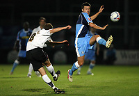 Photo: Rich Eaton.<br /> <br /> Hereford United v Wycombe Wanderers. Coca Cola League 2. 12/09/2006. Trent McClenahan right of Hereford clears under pressure from Russell Martin of Wycombe