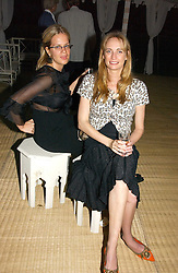 Left to right, CAMILLA LONG and CLEMENTINE HAMBRO at a party to celebrate the publication of Notting Hell by Rachel Johnson held in the gardens of 1 Rosmead Road, London W11 on 4th September 2006.<br />