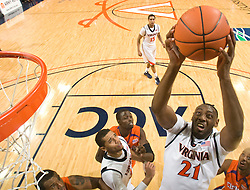 Virginia center Tunji Soroye (21) grabs a rebound against Clemson.  The Virginia Cavaliers defeated the #12 ranked Clemson Tigers in overtime 85-81 at the John Paul Jones Arena on the Grounds of the University of Virginia in Charlottesville, VA on February 15, 2009.