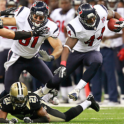 August 25, 2012; New Orleans, LA, USA; Houston Texans running back Ben Tate (44) jumps through a tackle by New Orleans Saints cornerback Patrick Robinson (21) during the first quarter of a preseason game at the Mercedes-Benz Superdome. Mandatory Credit: Derick E. Hingle-US PRESSWIRE