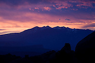 Sunrise behind the La Sal Mountains from Arches National Park, near Moab, Utah.