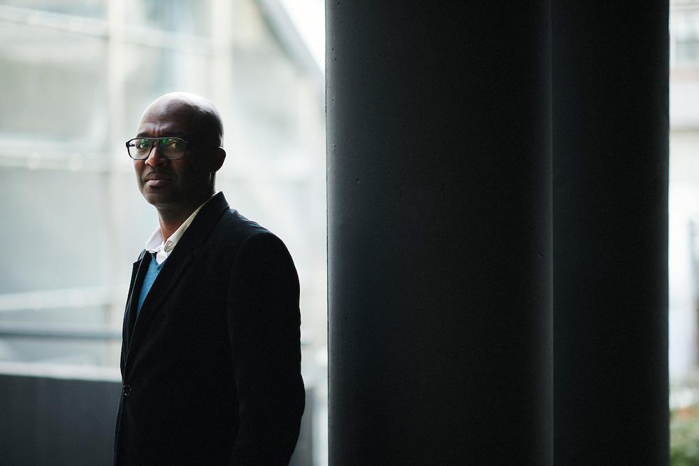 Paris La Defense, France. December 21, 2015. Martial Ze Belinga, economist and sociologist, posing in La Defense. Photo: Antoine Doyen