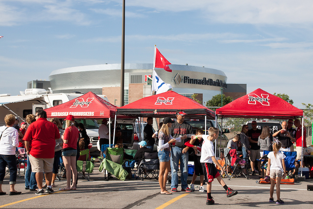September 14, 2013: Husker fans tailgating with the Pinnacle Bank Arena in the background before the game against the UCLA Bruins at Memorial Stadium in Lincoln, Nebraska. UCLA defeated Nebraska 41 to 21.