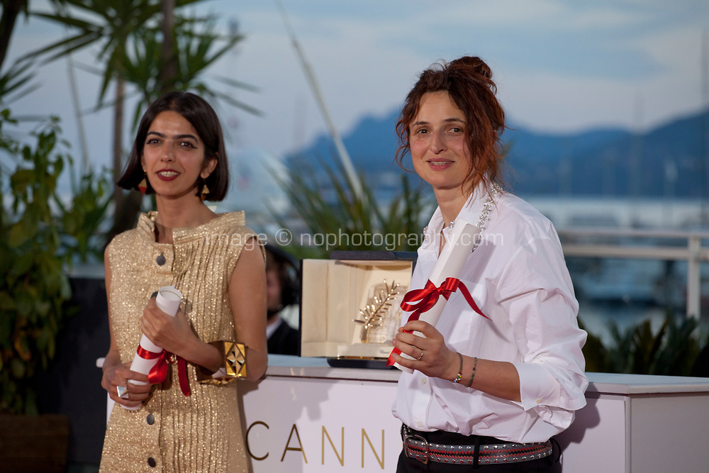 Actress Solmaz Panahi, representing her father Jafar Panahi, and Italian director Alice Rohrwacher joint winners of the Best Screenplay prize respectively for the films 3 Faces (Se Rokh) and Lazzaro Felice (Happy as Lazzaro) at the Award Winner's photo call at the 71st Cannes Film Festival, Saturday 19th May 2018, Cannes, France. Photo credit: Doreen Kennedy